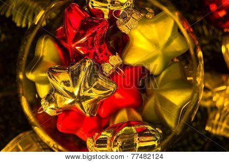 Christmas decoration, shiny colored stars in a glass bowl