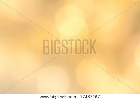 Gold Festive Christmas Background. Abstract Twinkled Bright Background With Natural Bokeh Defocused