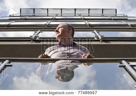Man Looking Toward The Sun From Modern Apartment