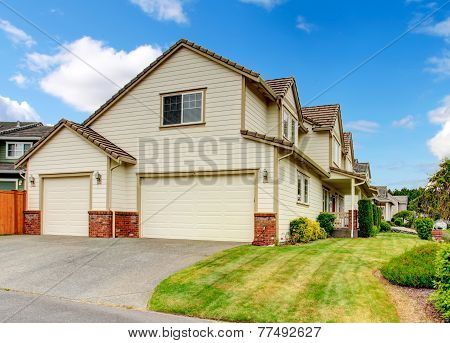 Large House With Garage And Driveway.