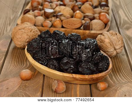 Dried Prunes In A Wooden Bowl