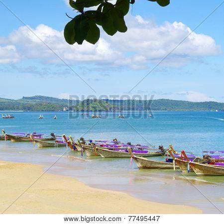 longtail boats on a tropical sea