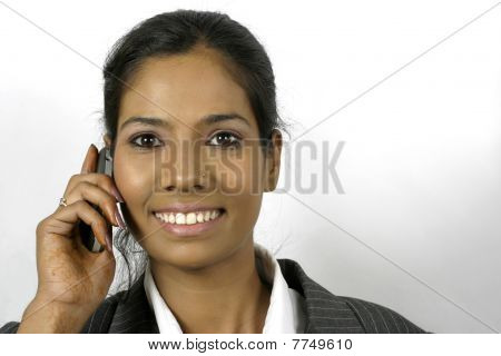 young indian buinesswoman calling on mobile