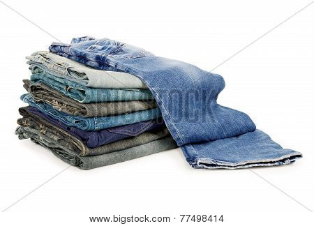 jeans Lot of different blue jeans isolated on white