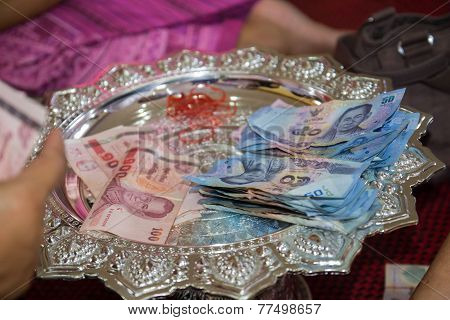 Fifty And Hundred Baht Thailand Banknote On A Tray