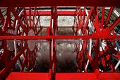 pic of natchez  - Red paddlewheel powering an old steamboat  - JPG