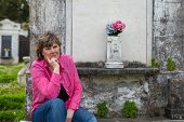 picture of burial-vault  - Woman in historic New Orleans cemetery - JPG