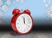 stock photo of count down  - Alarm clock counting down to twelve against snowflake wallpaper over floor boards - JPG