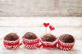 picture of chocolate muffin  - chocolate muffins on white wood background for Valentine - JPG