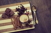 picture of cinnamon sticks  - Cup of hot coffe with cinnamon sticks on vintage wooden background - JPG