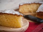 image of sponge-cake  - Portion of a sponge cake on a wooden plate in a studio shot - JPG
