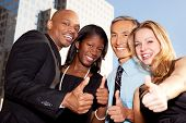 image of thumbs-up  - A group of business people giving a thumbs up sign - JPG