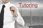 picture of tutor  - businessman in office writing tutoring in the air - JPG