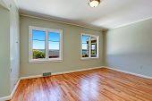 image of master bedroom  - Empty master bedroom interior with windows and hardwood floor - JPG