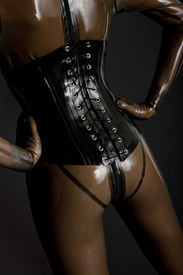 image of latex woman  - detail of young woman wearing latex clothes - JPG
