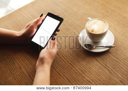 Woman using a touch screen of smartphone