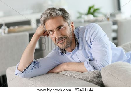 Portrait of mature man relaxing in sofa