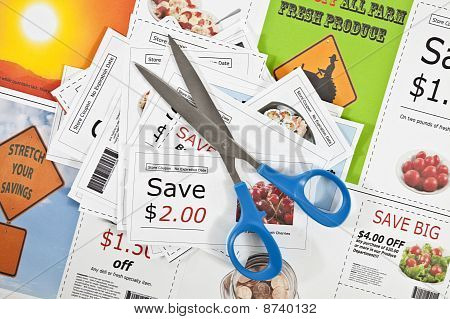 Fake Coupons On A Fake Coupon Background With Scissors.