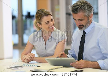 Business team working in office with tablet