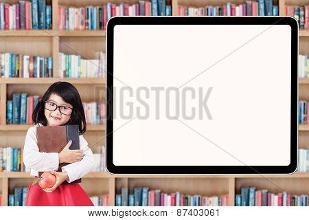 Attractive Little Schoolgirl With Billboard