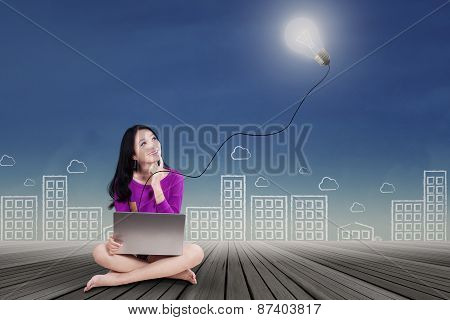 Cute Teenage Girl With Laptop And Lamp
