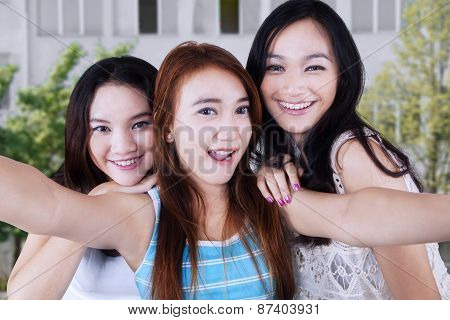 Excited Pretty Girls Taking A Selfie