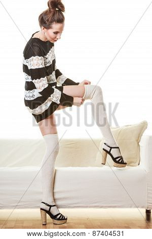Fashionable Girl Puts On Woolen Stockings