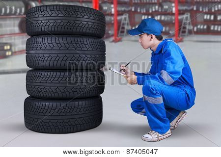 Mechanic Inspecting The Tires Texture