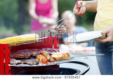 Woman Dishing Out Tasty Chuck Steak