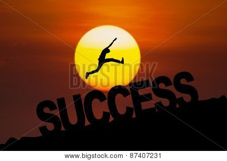 Successful Person Jumping At Sunset