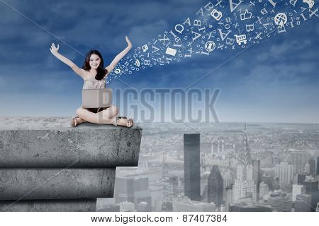 Teenage Girl With Laptop On A Roof