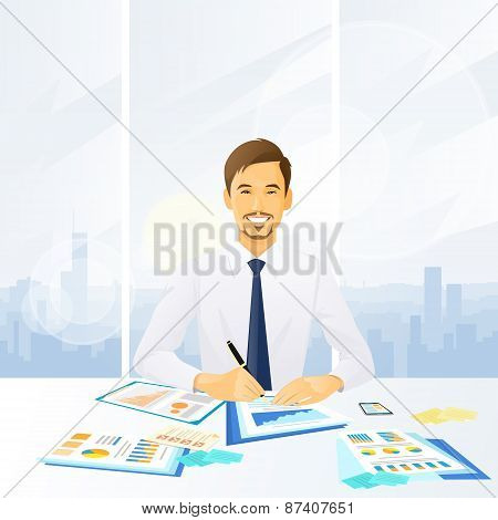businessman working with documents sitting at office