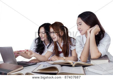 Three Student Studying On Desk