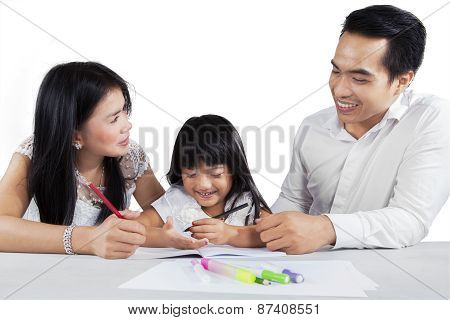 Two Parents Teach Their Child To Study