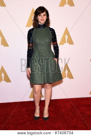 LOS ANGELES - FEB 02:  Felicity Jones arrives to the Oscar Nominee Reception  on February 2, 2015 in Beverly Hills, CA