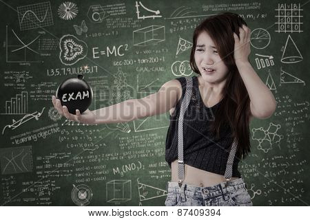 Worried Student With Bomb Of Exam