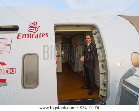 DUBAI, UAE - MARCH 31, 2015: Emirates crew member of Boeing-777. Emirates is one of two flag carriers of the United Arab Emirates along with Etihad Airways and is based in Dubai.