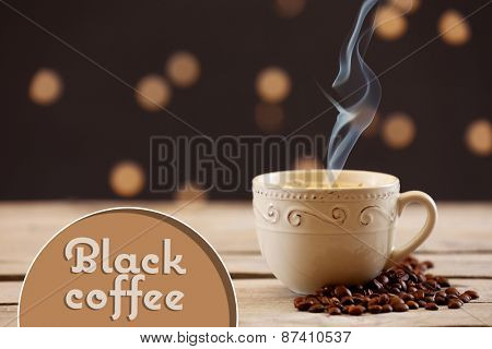 Cup of coffee on table on wooden table