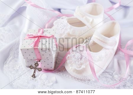 Baby shoe and cross for Christening