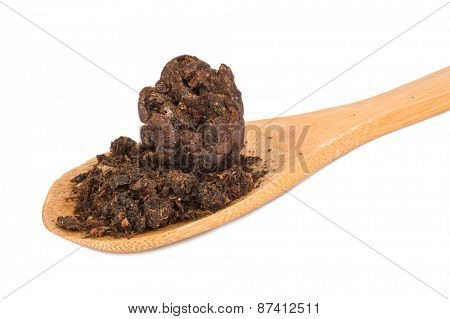Propolis bee on wooden spoon