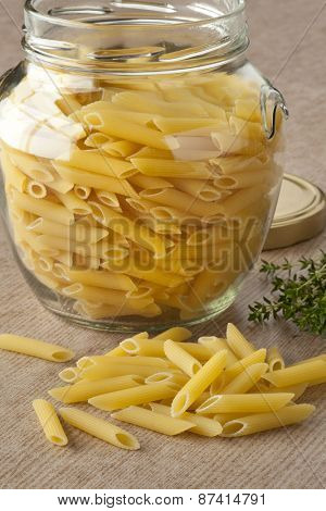 Traditional Italian penne rigate in a glass jar