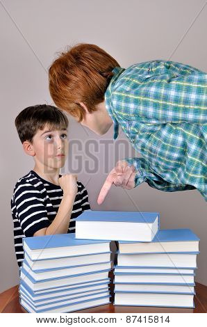 Woman showing books to a young boy