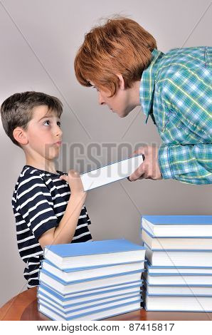 Woman showing a book to a young boy