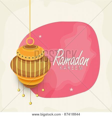 Hanging golden arabic lantern on shiny pink background for Islamic holy month of prayers, Ramadan Kareem celebrations.