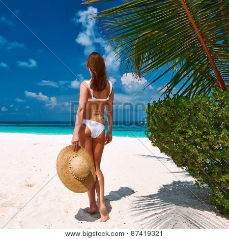 Woman in bikini on a tropical beach at Maldives