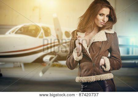 Portrait of beautiful woman aviator in airport
