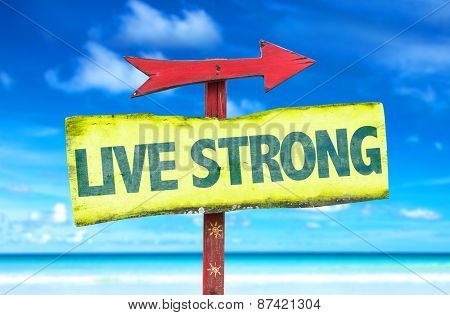 Live Strong sign with beach background
