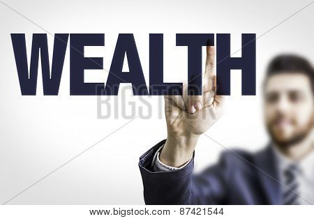 Business man pointing the text: Wealth