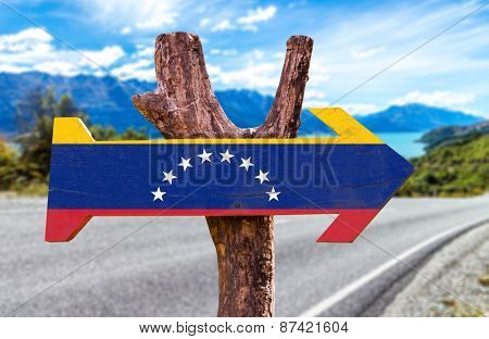 Venezuela Flag wooden sign with road background