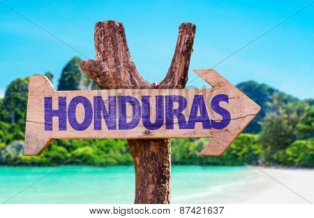 Honduras wooden sign with beach background